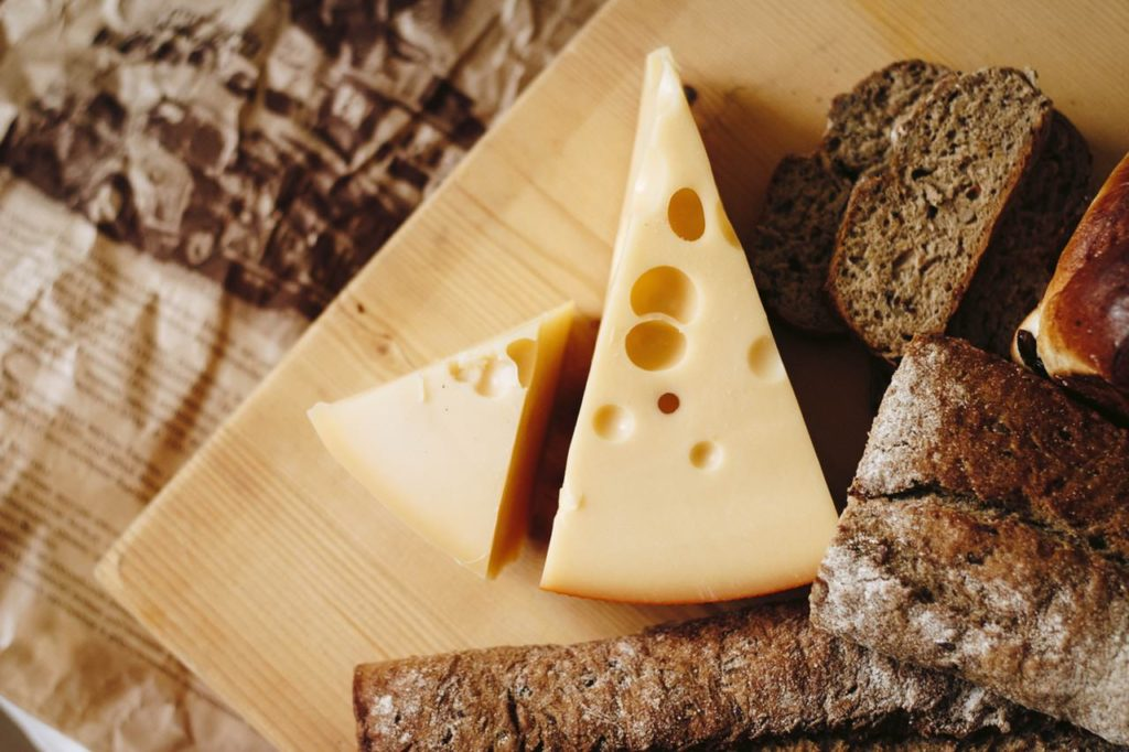 Image of probiotic cheese on a cutting board along with some bread