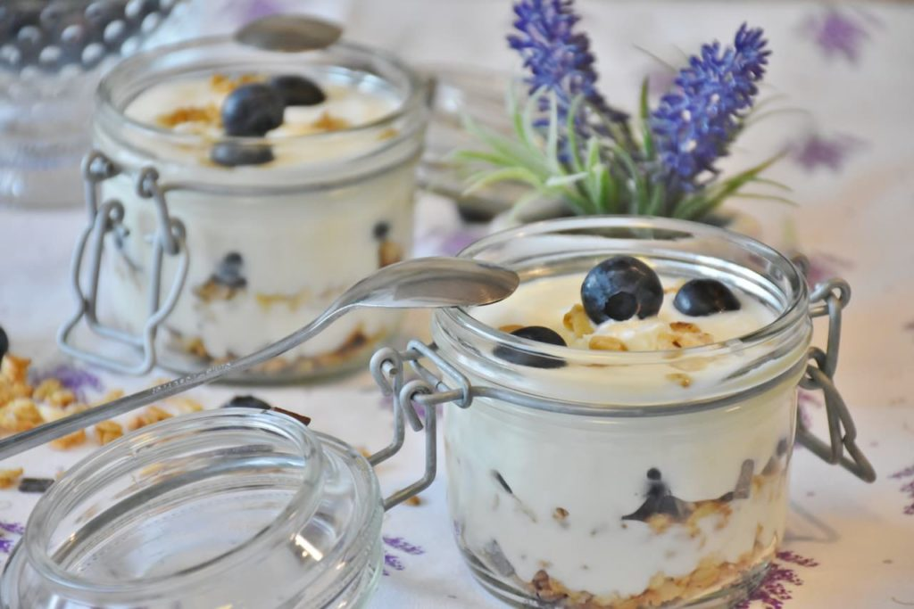Image of jars full of probiotic yogurt with blueberries on a table