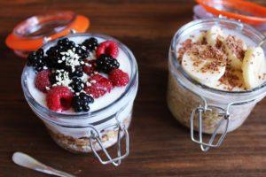 Image of two glass jars full of yogurt and fruit