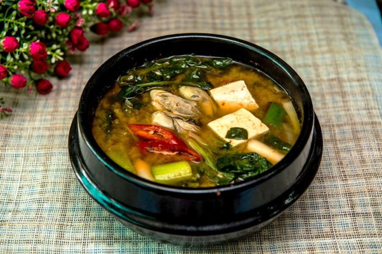 Image of a bowl of miso soup, which can contain the probiotic lactobacillus gasseri