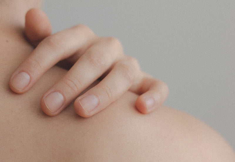 Image of someone's hand on their shoulder from behind