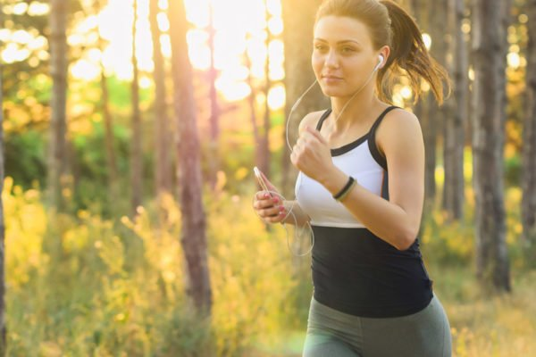 Image of a woman jogging in a forest