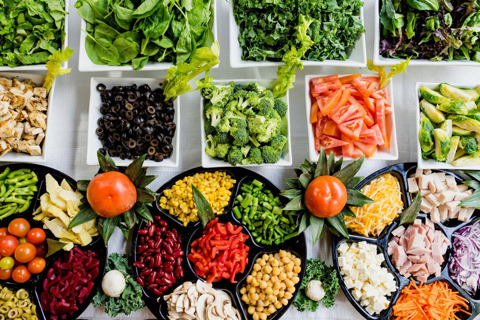 Image of a table full of fruits and vegetables that are good for nutrition
