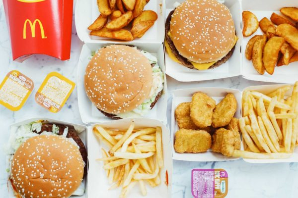 Image of unhealthy junk food on a table that are bad for nutrition