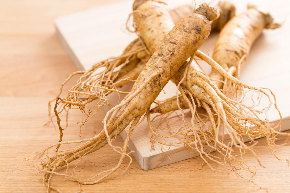 Image of ginseng on a cutting board and wooden table